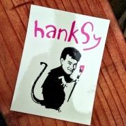 A fine silk screen sticker by famed street artist, Hanksy