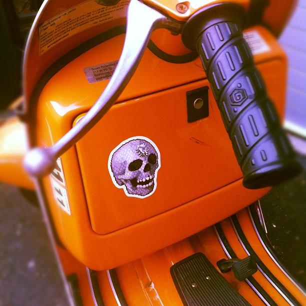 supersonic skull sticker on a vespa