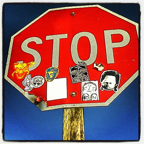 Stop sign covered in stickers